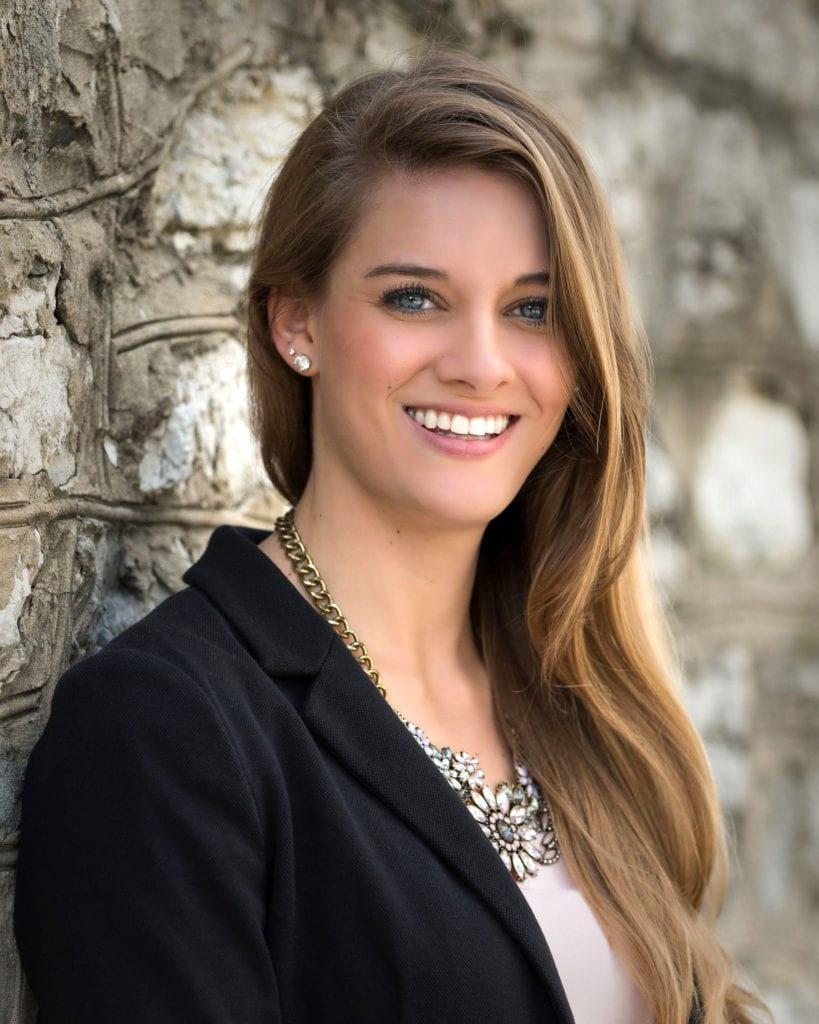 Branding headshot of a woman smiling
