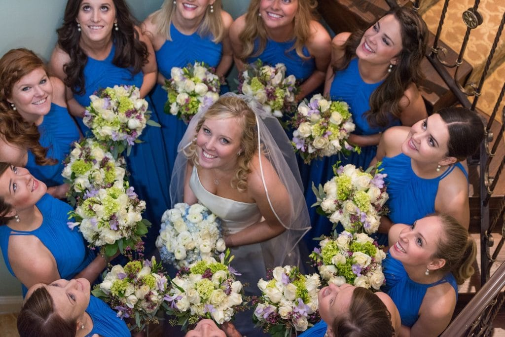 image of a bride surrounded by her bridesmaids holding bouquets