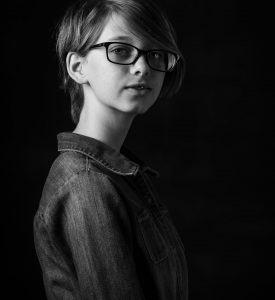 Headshot of a young girl wearing glasses